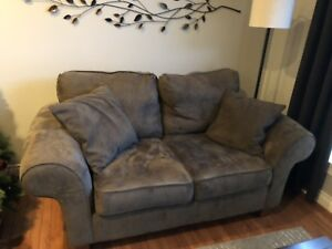 Brown micro suede sofa and love seat.