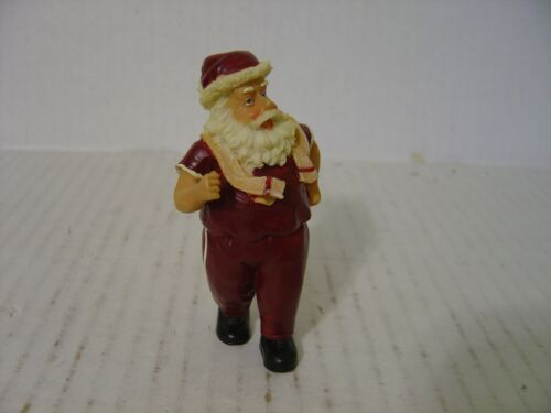 VERY CUTE SMALL RESIN SANTA CLAUS FIGURINE WITH SHORT SLEEVES AND SCARF