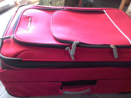 Airport red suitcase