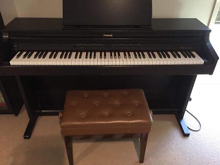 HP-2e Roland Digital Piano and Stool.
