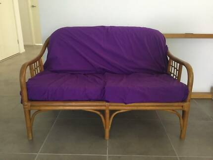 Rattan/timber couch with foam cushions. Used. Good condition.