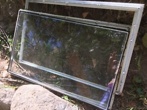 Free glass and plastic frame for a door