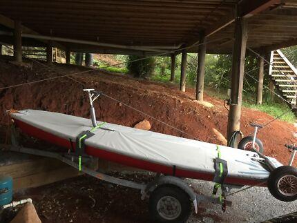 Laser Sailing Dinghy on registered road trailer