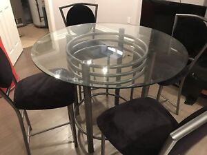 Unique glass hand crafted table and four chairs