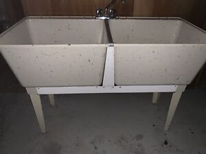 Double basin laundry sink with faucet