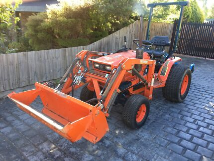 Kubota front end loader tractor with attachments