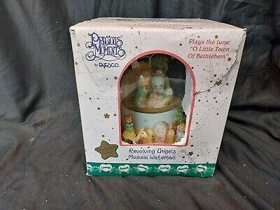 Precious Moments Nativity scene and snow globe Revolving Angels music