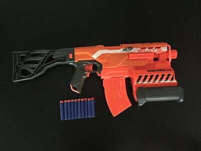 Nerf N-strike Elite demolisher 2-in-1with ten darts, no rockets.