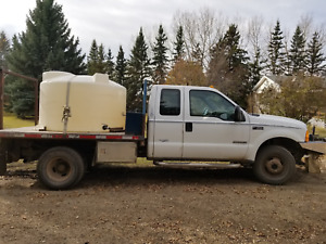 7.3 Ford diesel 1 Ton daully with trailer and water tanks