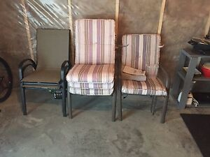 Table and 3 chairs and 4 cushions  $50.00