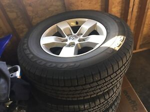 """4 Goodyear tires with 17"""" rims."""