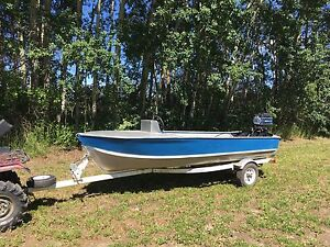 14 ft aluminum with 40/30 outboard jet