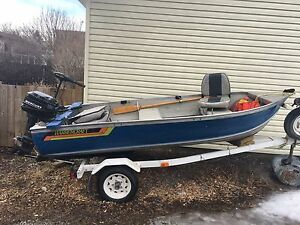 12' Aluminum fishing boat w/ 9.9HP Mercury outboard