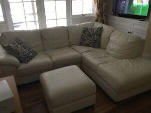 White Leather L shaped sofa plus footstool