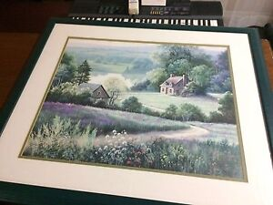 Beautiful framed artwork of a cottage in the meadow