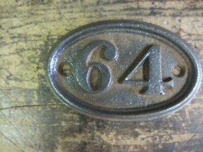 cast iron door number 64 -