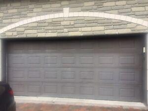 Used Garaga R16 insulated steel garage door 16x7 with parts