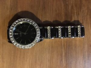 Black and silver Fossil watch