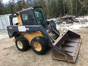 2012 John Deere 326 skid steer and attachments