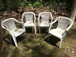 4 white resin chairs