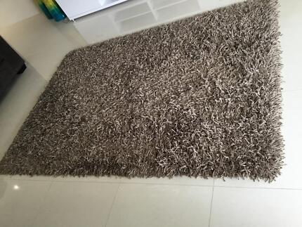 Large brown shaggy rug