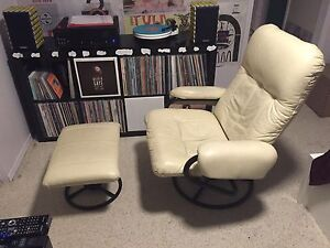 White leather reclining chair with black trim