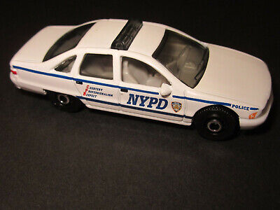 MATCHBOX 94 CHEVY  CAPRICE PARTS OF NYPD POLICE CAR SERIES WHITE  SINGLE