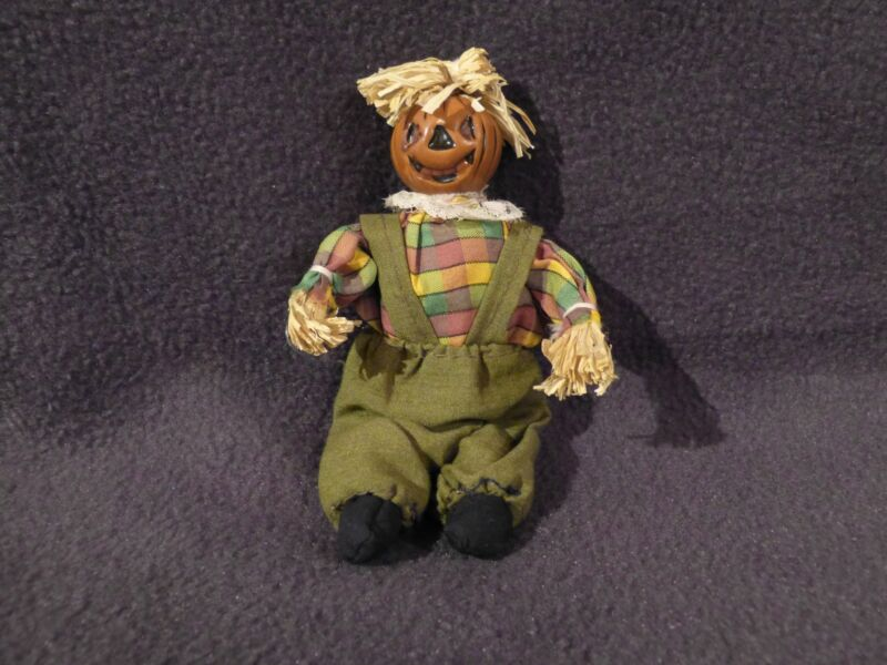 Small Halloween scarecrow figure, cloth body, straw accents, NEW