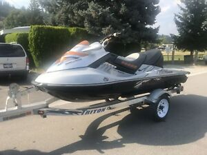 2008 Seadoo rxt with only 65 hours + aluminum triton trailer