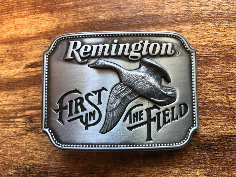 """VINTAGE REMINGTON ARMS """"FIRST IN THE FIELD"""" BELT BUCKLE MADE USA Canadian Goose"""