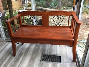 Solid hardwood and iron bench with storage