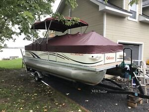 21' odyssey pontoon-great shape. 4 stroke engine and trailer