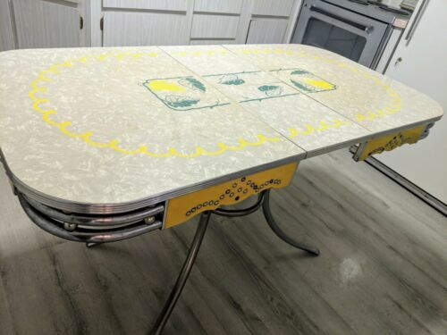 Mid century-vintage Formica & Chrome studded table with 4 chairs leaf motif