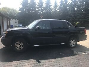 2004 Chev Avalanche and parts truck.