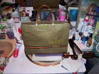 "1980 vintage 12"" x15 1/2"" Gucci shopping bag from Worth Ave. & crown sunglasses"