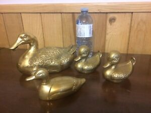 Brass ducks. X4. Vintage decorations.