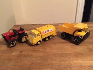 Vintage Tonka shell truck, dump mini truck and red lawn tractor