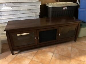 Dark wood Tv stand