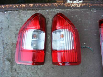 NISSAN NAVARA Dual Cab Ute TAIL LIGHTS , Pair. Factory fitted.