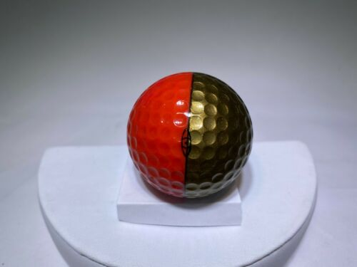 Gold and Red ping golf ball