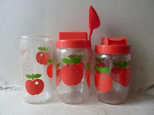 2-bocaux-et-1-verre-gradue-Henkel-France-pommes-rouge-vintage-An-70