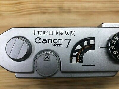 Canon 7, with factory engraving, working. cla'd this past year