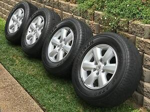 """4x Toyota Hilux SR5 17"""" Rims + Dunlop AT20 Tyres 265/65/17. Redlynch Cairns City Preview"""