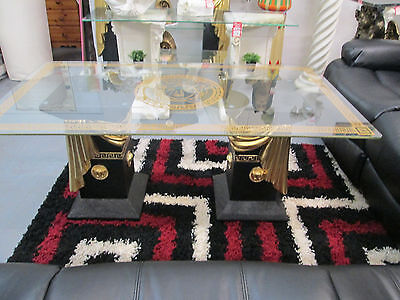 black and gold ribbon versace coffee table with medusa and greek key on glass