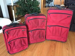 3 piece red luggage set with wheels