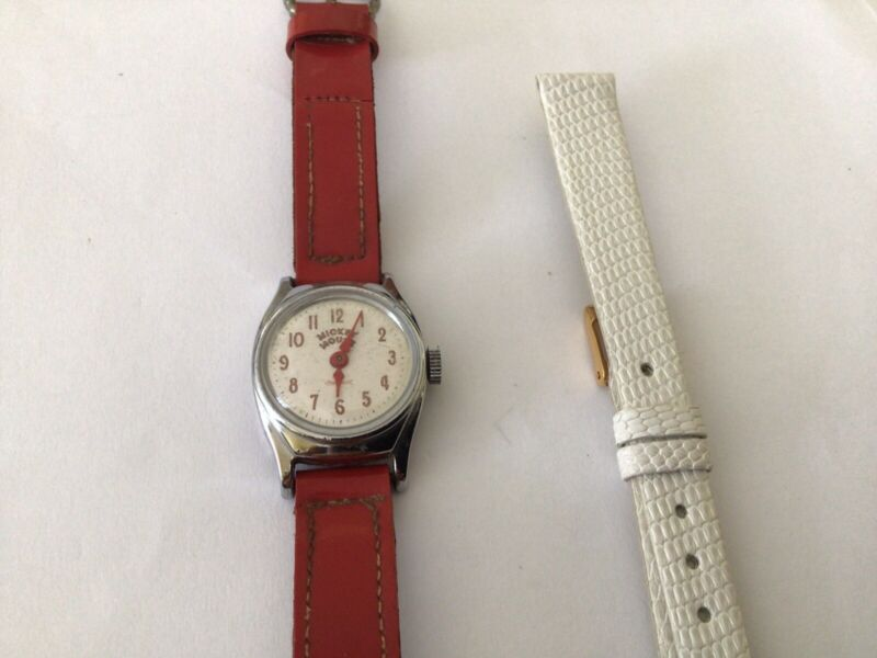 Vintage Mickey Mouse watch with original band.US time,and extra new band.Working