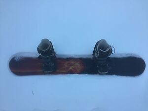 144 cm snowboard with bindings and size 9 women boots