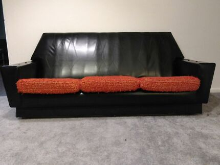 Circa 1960s retro black vinyl lounge suite.
