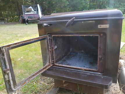 Wood burning combustion heater
