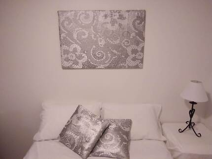 Decorative wall art with matching cushions